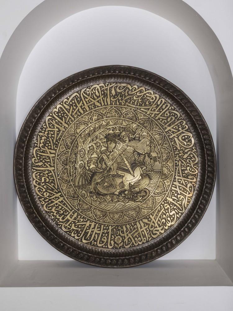 A plate depicting Saint George killing the dragon.<small>© Sheikh Faisal Bin Qassim Al Thani Museum</small>