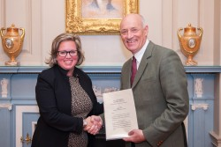 The US State Department Chief of Protocol accepted copies of credentials from Austria's Appointed Ambassador, Martin Weiss.<small>© U.S. Department of State</small>